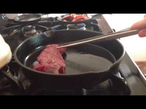 Cooking venison strip in a cast iron skillet