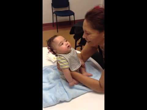 Cerebral palsy baby's expression and first smiles