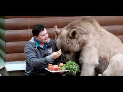Russian Couple Adopted An Orphaned Bear 23 Years Ago