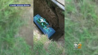 Family Horrified As Foot Lands On Adjacent Coffin