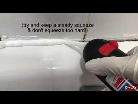 Applying the Unibond sealant in the bath
