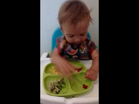 Cade eating finger foods--almost 9 months