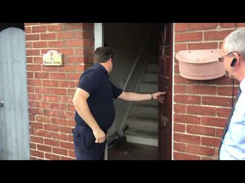 Bailiff enters repossessed property.