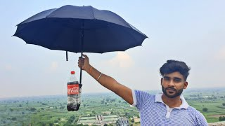 Can an Umbrella save this Coca cola | क्या छाता coldrink को फूटने से बचालेगा