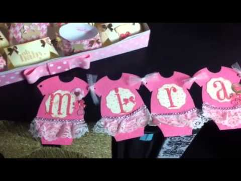 Finished baby banner favors and diaper cake with matching b