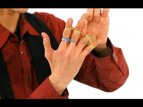 How to Do the Jumping Rubber Band Trick | Magic Tricks