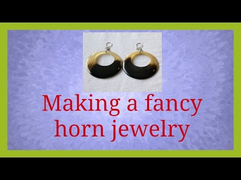 Polishing a  horn piece to make our fancy jewelry | Blossominspirations.com