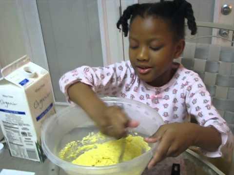 My baby teaching us how to make jiffy corn bread @6:-)