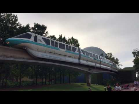Monorail Teal Gets Towed Through Future World at Epcot While Filled with Guests