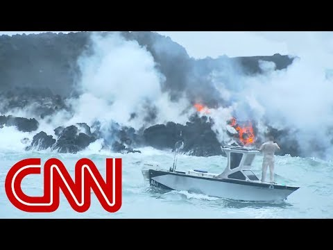 Fast-moving lava from volcano flows into Pacific Ocean