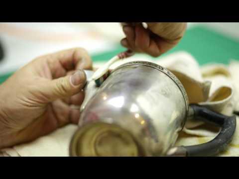 Polishing an old silver Teapot