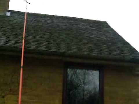 moss cleaning on a tiled roof