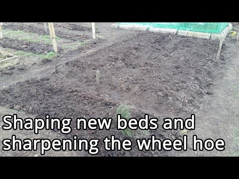 Shaping new beds and sharpening the wheel hoe