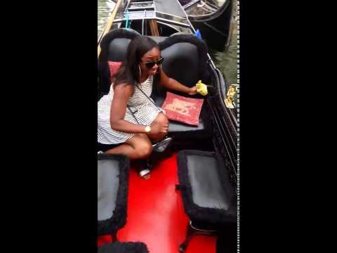 Getting in the gondola in Venice italy