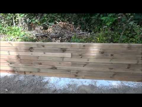 Vapour Barrier To Protect Landscaping Lumber-Retaining Wall