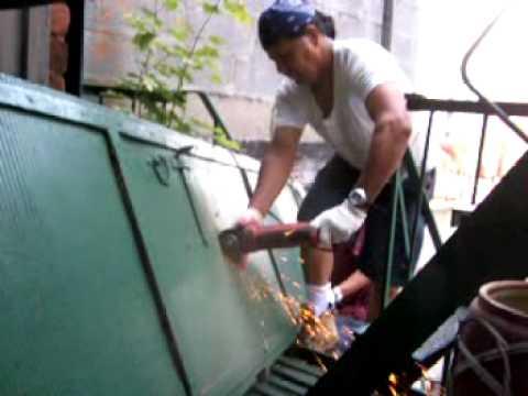 Jorge cutting a metal gate