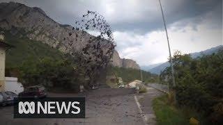 Powerful mudslide crashes through village in Switzerland, damaging cars and properties