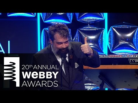 Brian Stelter presents to Chris Milk at the 20th Annual Webby Awards
