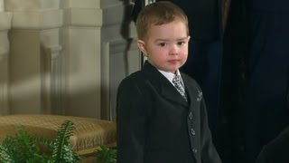 Little boy steals show at medal ceremony
