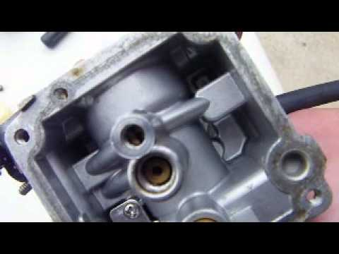 How to clean a carburetor on an 8hp Mercury outboard engine