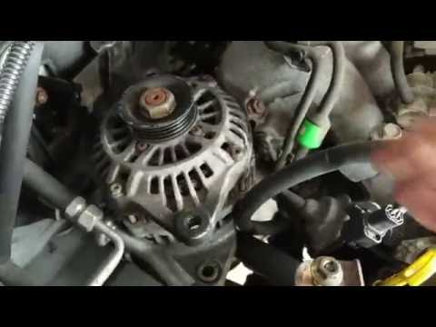 How to remove the alternator out of the engine bay 2001 2002 2003 Mazda Protege