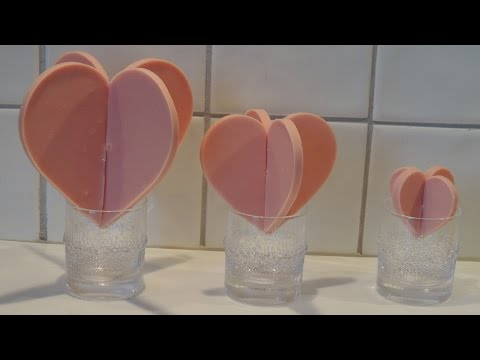 Homemade 3D pink chocolate heart for Valentine's Day in silicone mold (mould)