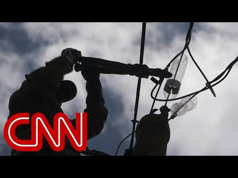Puerto Ricans repair power lines themselves as they brace for the next hurricane season