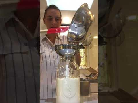 Straining milk kefir grains