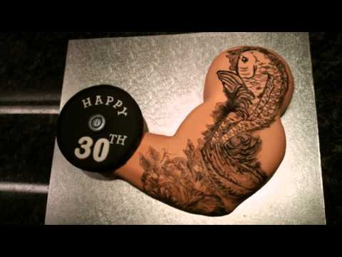 Tattoo muscle arm cake