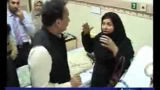 An Ahmadi woman refusing Rehman Malik ! take these flowers back to president
