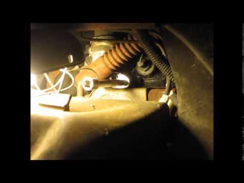 spark plug behind steering column