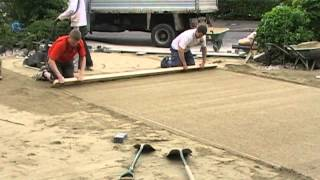 Screeding A Paving Laying Course