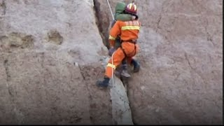 Firefighters rescue boy stuck in crevice on sheer cliff