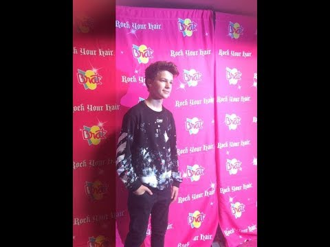 Hayden Summerall and Annie leBlanc singing at rock your hair concert