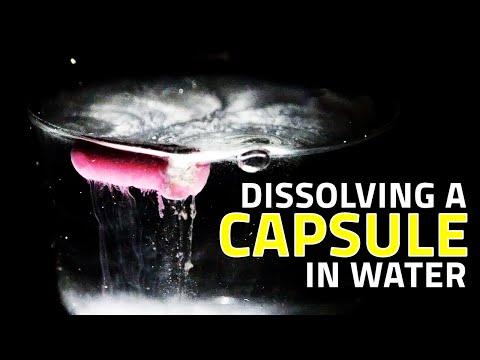 Dissolving A Capsule In Water - HD