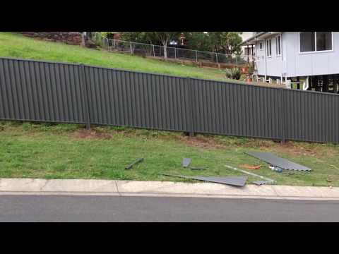 Fence on a slope  Heal Steel Fencing   Bluescope Steel   Colorbond® Steel