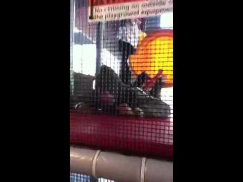 Kid goes down slide on penny board