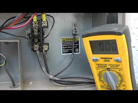 Testing Phoenix AZ A/C unit at the contactor by pushing 'plunger' or button - thermal-medics.com