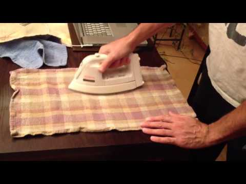 How to remove heat stains from wood furniture using an iron