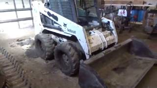 Bobcat 753 pulling out axle Videos & Books