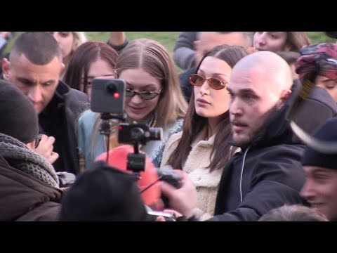 Gigi and Bella Hadid gets swarmed by a massive crowd of fans after the Alberta Ferretti Show