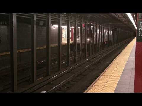 R160 E subway train departs 34th Street Penn Station