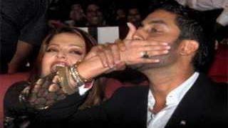 Aishwarya Rai & Abhishek Bachchan indulge in PDA