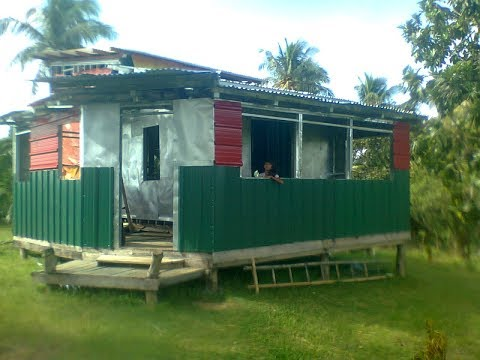 PUTTING UP WINDOWS ON OUR HOUSE EXPAT FOREIGNER PHILIPPINES