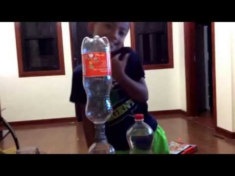 How to make a tornado with 2 bottles 2 bottle caps and big gray tape so easy!!!!!!!!!!!!!