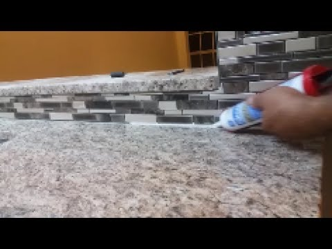 How To Caulk  On a Kitchen Backsplash - seal the gap between granite and mosaic.