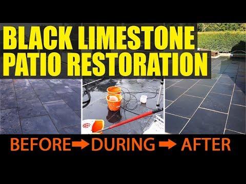 Acid damaged black limestone patio tiles in Bromsgrove