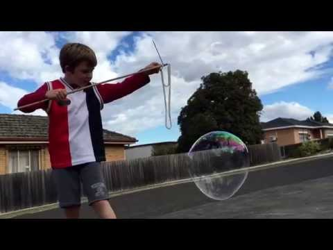 Making simple tri-string bubble wands.
