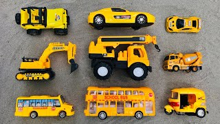 Find different types of yellow toy vehicles in the sand - Excavator, Sports Car, School Bus