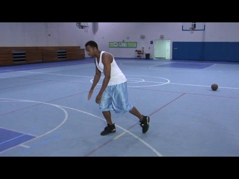 Improving Basketball Skills : Basketball Between-The-Legs Spin Move Into a Layup